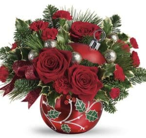 Hand-glazed with a shimmering finish and jolly holly details, this keepsake ornament jar is a festive vase for a lush Christmas bouquet, of red roses.