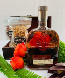 A bottle of Woodford Reserve Bourbon is the perfect choice no matter what the celebratory occasion may be. When sending this bottle, you are also sending Grapevine, Texas' own Valerie's Thyme large cashews and small almonds to compliment. Our hand tied jewel toned blooms are the final touch.